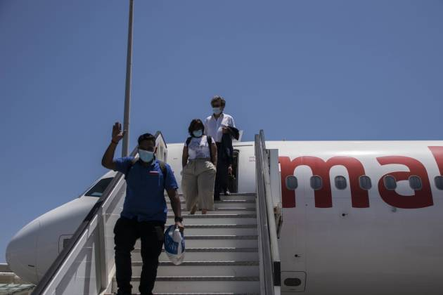 air-malta-passenger-waves-at-journalists-1st-flight-after-months-of-airport-closure
