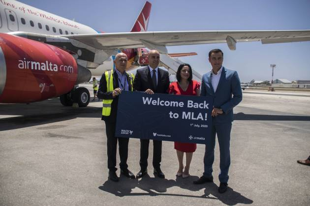 julia-farrugia-portelli-and-silvio-schembri-welcome-air-malta-passengers-after-months-of-airport-closure