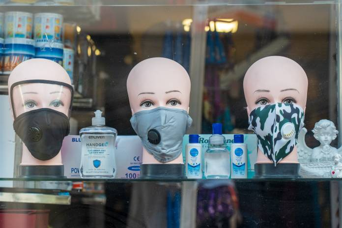 A shop window, selling face masks and sanitizer, during the COVID-19 pandemic.